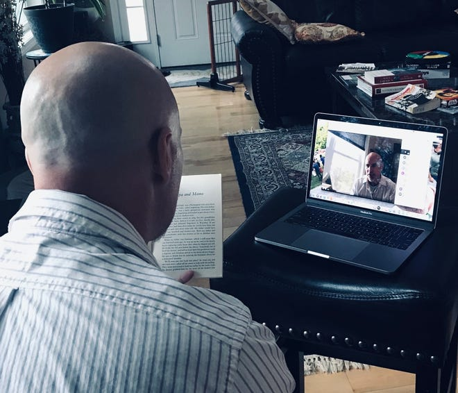Joe Resteghini, principal of Champlain Elementary, reads to  students over livestream while they participate in remote learning during the COVID-19 pandemic.