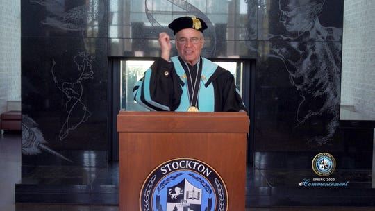 President Harvey Kesselman does a symbolic turning of the tassel at the Stockton University eCommencement.