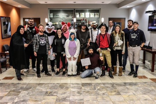 Shoptech team members holds their Halloween party.