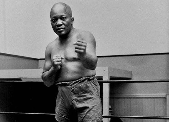 In this 1932 file photo, boxer Jack Johnson, the first black world heavyweight champion, poses in New York City. President Donald Trump on May 24, 2018, granted a rare posthumous pardon to boxing's first black heavyweight champion, clearing Johnson's name more than 100 years after a racially-charged conviction. Sylvester Stallone has announced plans for a biopic on heavyweight champion.