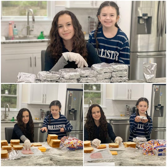 Sarah Alves and Leah Alves of Springfield make sandwiches for homeless shelters.