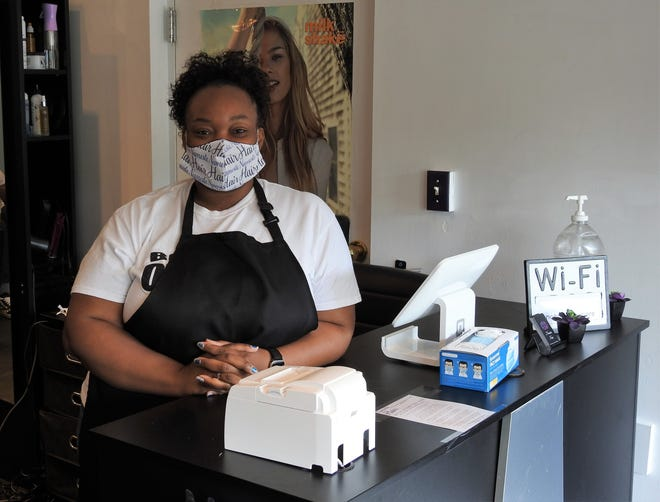 Danielle Davis of Namaste Hair Salon opened her new shop Friday in Newcomerstown. This coincided with the state allowing salons and barbershops to reopen to customer with extra precautions in place relating to the COVID-19 pandemic.