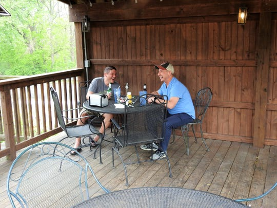 Brothers Jesse and Jeremiah Kline of Columbus share a laugh and beer while waiting on food on the patio of the Warehouse Steak 'n Stein in Roscoe Village. Friday was the first day restaurants with outdoor dining could serve seated guests.