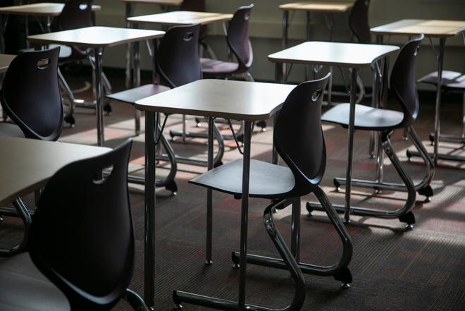 Desks sit empty at U of D Jesuit in Detroit as schools were ordered shut as Coronavirus threats loom Friday, March, 13, 2020.