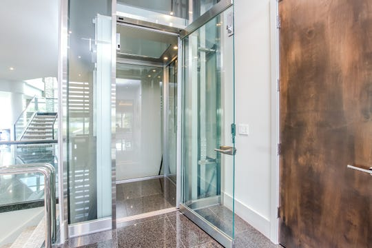 A glass elevator services all three floors  in the home of Detroit Lions quarterback Matthew Stafford at 1867 Long Pointe Drive in Bloomfield Twp. The home  is on sale for $6.5 million. The five-bedroom, seven-bathroom lakefront palace features 12,295 square feet, including 7,720 above ground.