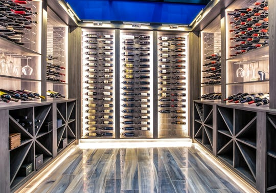The home of Detroit Lions quarterback Matthew Stafford at 1867 Long Pointe Drive in Bloomfield Twp. features a 625-bottle, temperature controlled wine cellar. The palace is on sale for $6.5 million. The five-bedroom, seven-bathroom lakefront home features 12,295 square feet, including 7,720 above ground.