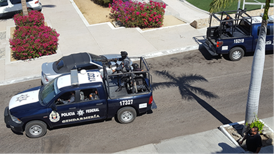 Market analyst Jon Gabrielsen took this photo of police in Mexico patrolling the streets with machine guns in May 2018. He said these officers, in these vehicles, were enforcing shelter-in-place mandates on Wednesday. Gabrielsen watched police approach violators in the park and send them home.