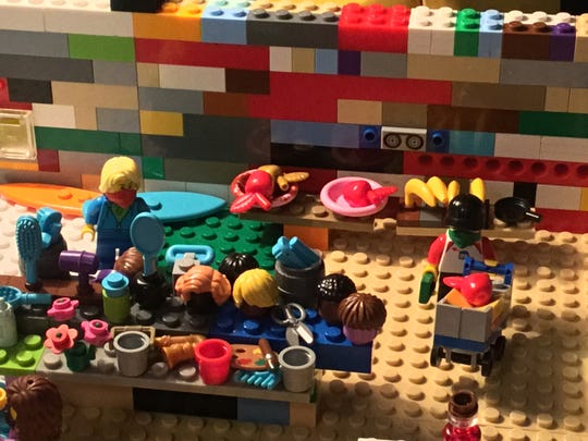 Xan Clarkson's Lego grocery store includes masked shoppers - a sign of the times during the novel coronavirus.