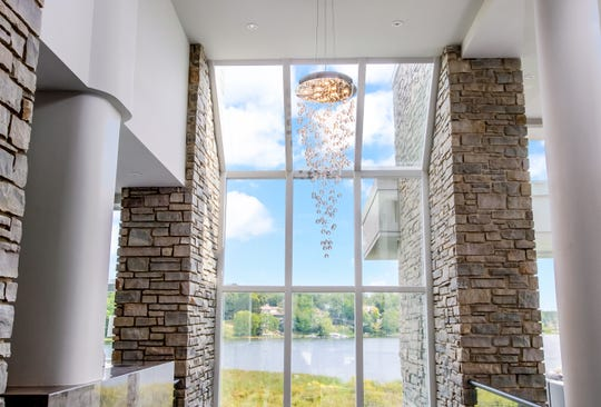A chandelier hangs in the home of Detroit Lions quarterback Matthew Stafford at 1867 Long Pointe Drive in Bloomfield Twp. The  house is on sale for $6.5 million. The five-bedroom, seven-bathroom lakefront home features 12,295 square feet, including 7,720 above ground. The home overlooks Upper Long Lake.