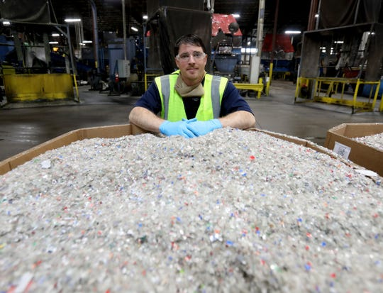 Jeremy Kraft the operation manager at Schupan Recycling in Wixom, Michigan on May 15, 2020, with hundreds of pounds of plastic cut up and processed from various pop bottles. Most of the recycle center was idled from late March to mid-June by Gov. Gretchen Whitmer's coronavirus executive orders that forbade the bottle and can redemptions.