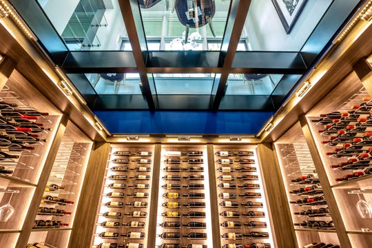 The lower level wine cellar has a ceiling made of glass that looks up into a dining area. Perhaps it lets the host check a wine selection with guests.