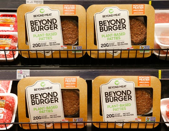 A meatless burger parry called Beyond Burger is on display at a grocery store in Richmond, Va. in this June 27, 2019, file photo. Offerings from companies like Beyond Meat Inc. and Impossible Foods Inc. have seen sales jumping 264% during the coronavirus pandemic.
