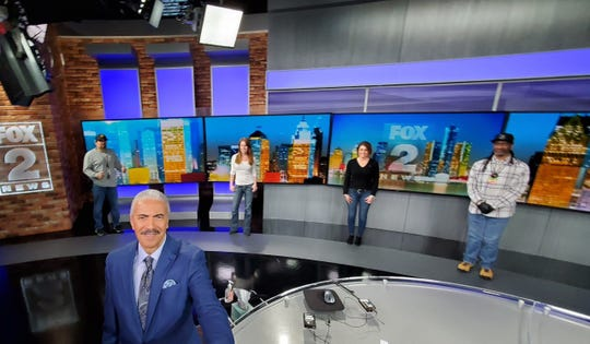 Huel Perkins, foreground, along with Bob Richards, Rebecca Abramson, Kim Brancato and Chinelo Azibo. Like most TV news teams during the coronavirus pandemic, Fox 2 is working with a reduced in-office staff these days.