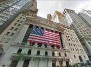 A U.S. flag is draped across the front of the New York Stock Exchange in Manhattan.