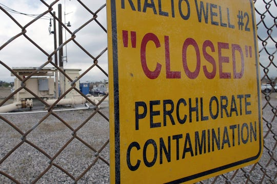 FILE - In this March 28, 2005 file photo a sign posted outside a water well indicates perchlorate contamination at the site in Rialto, Calif.