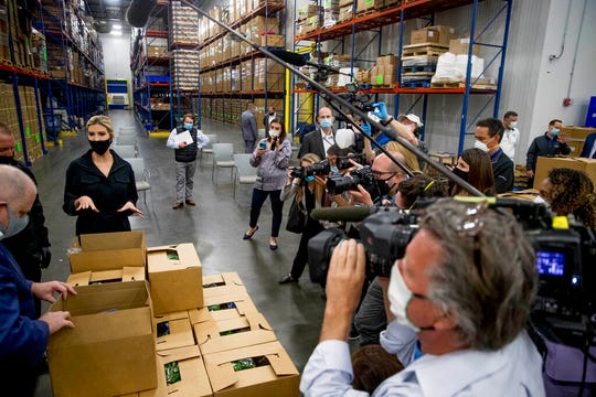Maryland Gov. Larry Hogan, left, and Ivanka Trump, the daughter of President Donald Trump, second from left, look through boxes of produce as they tour Coastal Sunbelt Produce, Friday, May 15, 2020, in Laurel, Md.