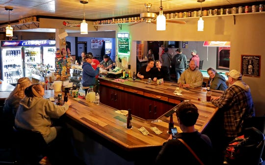 Club Ritz opens to patrons following the Wisconsin Supreme Court's decision to strike down Gov. Tony Evers' safer-at-home order amid the coronavirus pandemic, Wednesday, May 13, 2020, in Kaukauna, Wis.