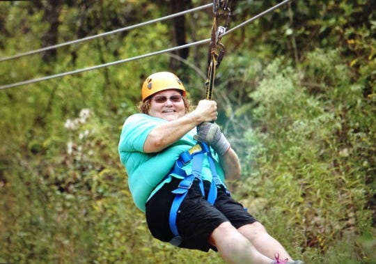Marsha Bantle ziplines during a family trip to Branson, Missouri.
