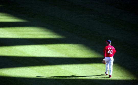 Cardinals pitcher Andy Benes walks through the outfield at Busch Stadium before the start of the third game of the National League Division Series Saturday, Oct. 5, 2002.