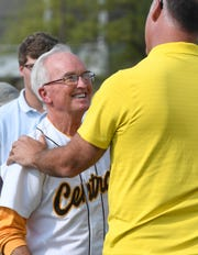 Paul Gries talks with 1985 Central graduate and former St. Louis Cardinals pitcher Andy Benes at the dedication ceremony to rename the school's field to Paul Gries Field Tuesday, April 18, 2017.