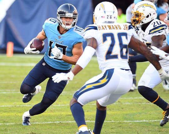 Oct 20, 2019; Nashville, TN, USA; Tennessee Titans wide receiver Adam Humphries (10) runs after a catch during the second half against the Los Angeles Chargers at Nissan Stadium. Mandatory Credit: Christopher Hanewinckel-USA TODAY Sports
