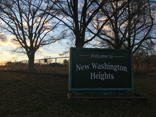 The sun sets behind the entrance to the New Washington Heights community north of Greenville, South Carolina, on Feb. 28, 2020. Behind the chain-link fence are the former grounds of the all-black Washington High School, torn down in 2015.