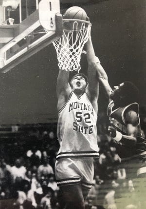 Montana State post player Doug Hashley reaches up to throw one down in this undated photo. The former Big Sandy standout, now University of Providence athletic director, ranks second on the Bobcats' all-time rebounding list and No. 7 on the Big Sky list.