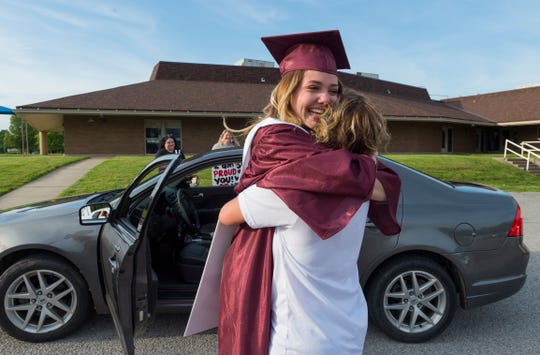 Henderson County High School senior Jada Townsend, left, hugs her mother Denisa Townsend during the Senior Drive at East Heights Elementary Thursday evening, May 14, 2020. Instead of the traditional Senior Walk, a Senior Drive took place with the graduates and their families driving through the campuses where they were greeted by former teachers and staff.  School buildings have been closed since mid-March because of the COVID-19 pandemic.