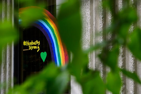"""A hand-painted rainbow with the message """"Kentucky Strong"""" is seen on a window of the Henderson County Public Library in Downtown Henderson, Ky., Friday afternoon, May 15, 2020. The library's facilities have been closed to the public since March 16 due to restrictions put in place to curb the spread of COVID-19."""