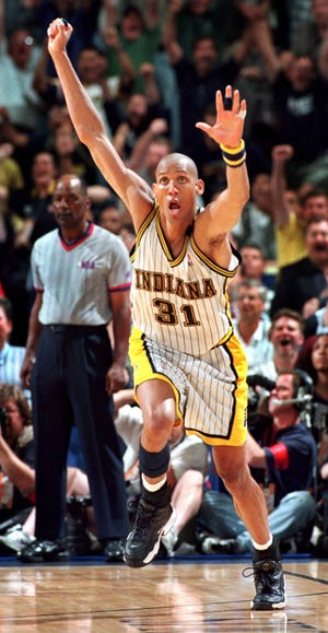 Indiana Pacers Reggie Miller reacts to hitting the game winning 3 point shot with .07 seconds left in the game to beat Chicago 96-94 in game #4 of the Eastern Conference Finals at Market Square Arena Monday, May 25, 1998. The best of seven series is now tied at 2 games apiece.