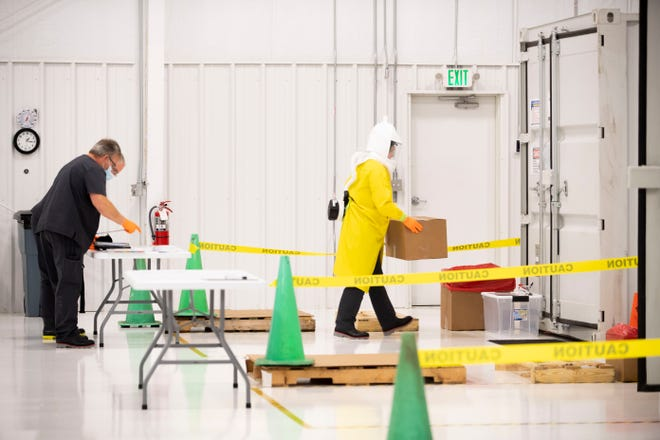 Battelle's decontamination technicians do a training session   at the McKellar-Sipes Regional Airport, in Jackson, Tenn., Wednesday, May 13, 2020. The employees go through a mock trial without masks to go through the sessions of how the Critical Care Decontamination System works.