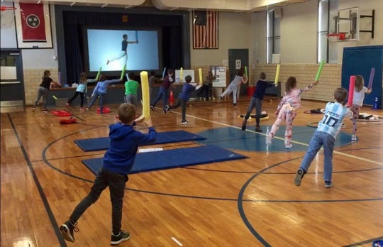 Second grade students at Sequoyah Elementary are shown practicing Jedi balance exercises during a physical education class of the 2019-20 school year.