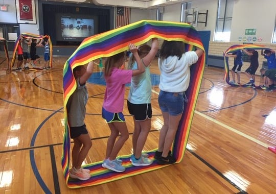 Fourth graders at Sequoyah Elementary develop teamwork and problem solving skills in a Rainbow Mover during one of teacher Becca Russell's creative PE exercises. The veteran teacher was named 2019-20 Teacher of the Year for Sequoyah Elementary by the Knox County Schools.