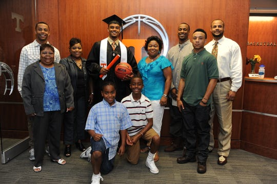 Jordan Bone, front right, attends his brother Josh Bone's graduation at the University of Tennessee in 2011. Bone was surprised with a graduation gift from the university on ESPN on Friday, May 15, 2020.
