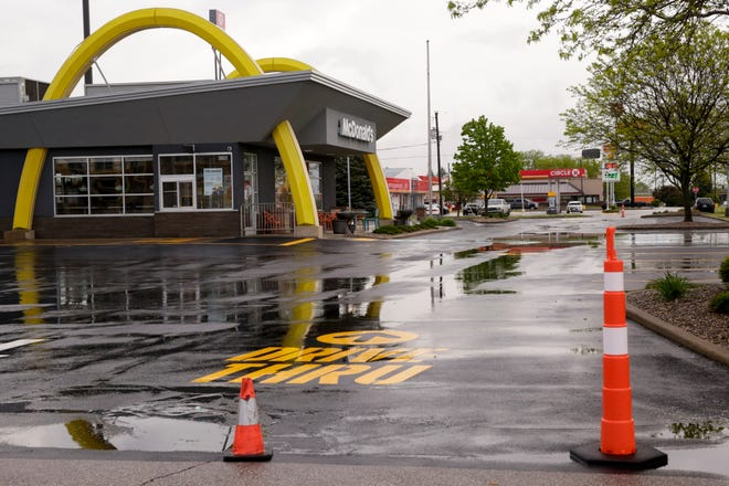 Cones block the entrance to a McDonalds, located at 4200 South St., with signs advising of their temporary closure posted on its doors, Friday, May 15, 2020 in Lafayette.