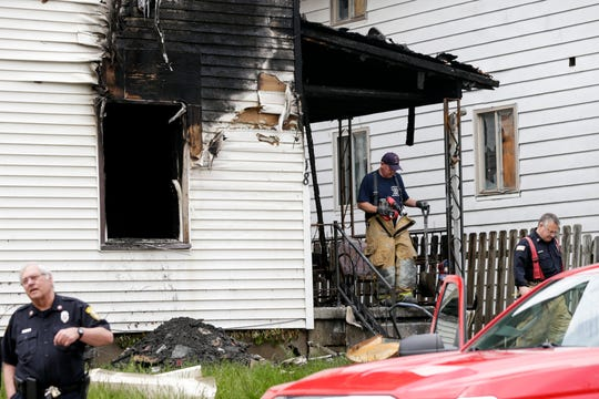 The Lafayette Fire Department investigates the scene of an early morning fatal fire on the 900 block of North 11th Street, Friday, May 15, 2020 in Lafayette. Two people died in the fire, the cause of the fire is under investigation.