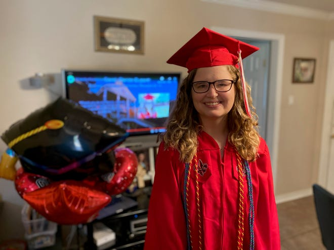 Sarah Dupont, 23, of Kenner is a spring 2020 graduate of the University of Louisiana at Lafayette. She celebrates with her family at home watching a virtual commencement ceremony via livestream May 15, 2020.