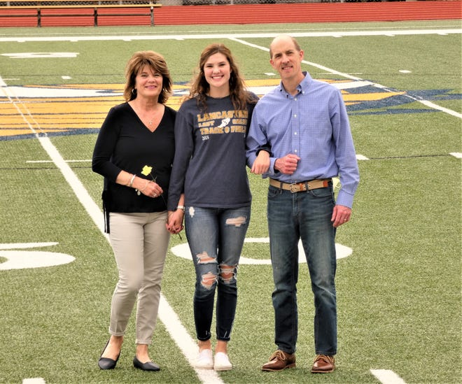 Lancaster track and field senior Hallie Rose was honored Thursday at Fulton field with her parents, Tom and Susan by her side.