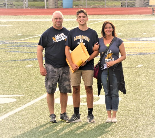 Lancaster track and field senior Caleb Cordle was honored Thursday at Fulton field with his parents, Jeff and Kelly by his side.