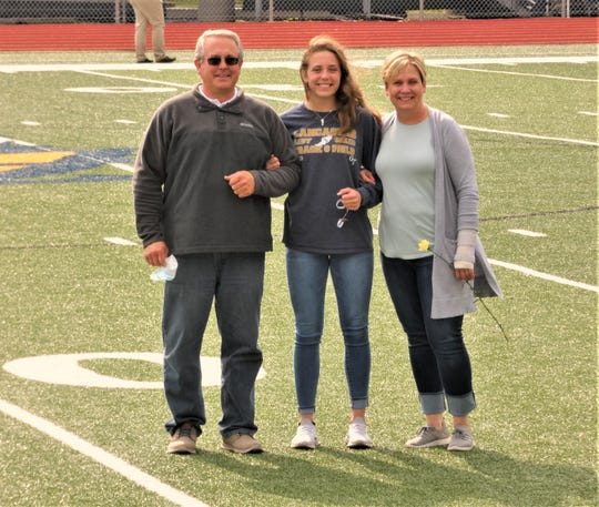 Lancaster track and field senior Savannah Dryden was honored Thursday at Fulton field with her parents, David and Christina by her side.
