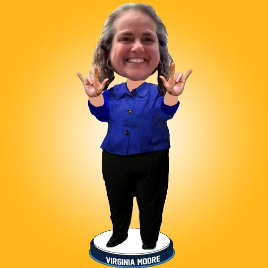 The National Bobblehead Hall of Fame and Museum has released a bobblehead of Virginia Moore, the executive director of the Kentucky Commission on the Deaf and Hard of Hearing who has also been the sign language interpreter for Gov. Andy Beshear's daily coronavirus briefings.