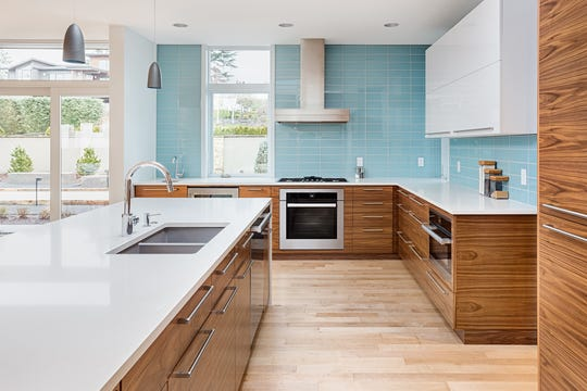 Add a pop of intrigue to your kitchen through a bright backsplash, colorful kitchen island or a dropped ceiling with rich wood tones.