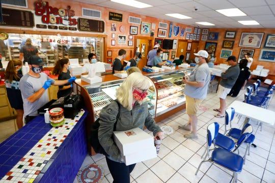 Gibson's Donuts reopens Friday, May 15, 2020 after being closed for two months during the economic shutdown of the caused by the city coronavirus pandemic.