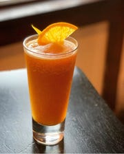 The frozen Rye Slyce at Bari Ristorante. Hunter Coleman's frozen cocktail is made with Averna Amaro, rye whiskey and fresh squeezed orange juice.