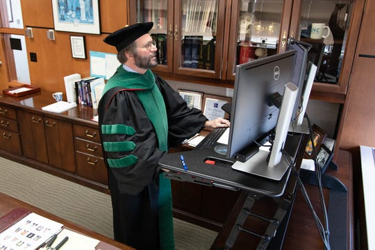 University of Wisconsin School of Medicine and Public Health Dean Robert Golden participates in the school's first virtual graduation ceremony held during the COVID-19 pandemic.