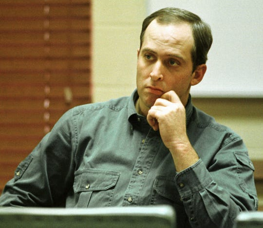 """Robert Todd Burmingham listens to proceedings at his pre-trial hearing at the Lee County Courthouse in Marianna on Jan. 16, 1998. Burmingham, who was serving a life sentence for the so-called """"Blue Light Rapes"""" has died after testing positive for the new coronavirus, Gov. Asa Hutchinson said Thursday."""