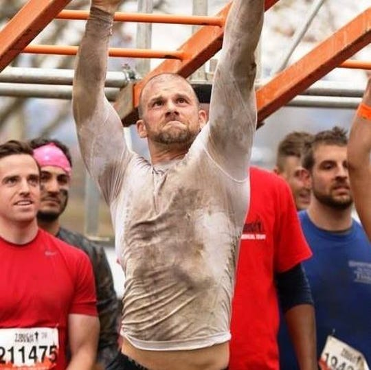 Matt Scarfo in a tough-mudder competition. Scarfo impulsively ran from his Morristown fitness center to Trenton April 28 to join a rally to support opening small businesses.