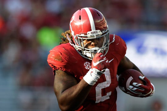 Alabama running back Derrick Henry (2) runs the ball in for a touchdown against Middle Tennessee, Saturday, Sept. 12, 2015, in Tuscaloosa, Ala.