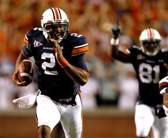 Auburn quarterback Cam Newton (2) runs for a touchdown against South Carolina on Saturday, Sept. 25, 2010, in Auburn, Ala.