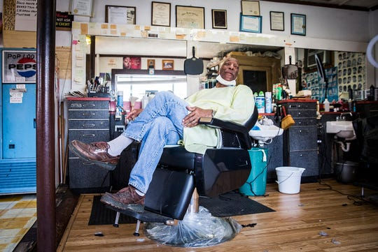 Owner of Carey's Superior Barbershop, Thomas Carey, waits for clients on the south side of Muncie Wednesday, May 13, 2020. Carey said his wife, who's a trained nurse, has been relentless in getting him to wear PPE while working.
